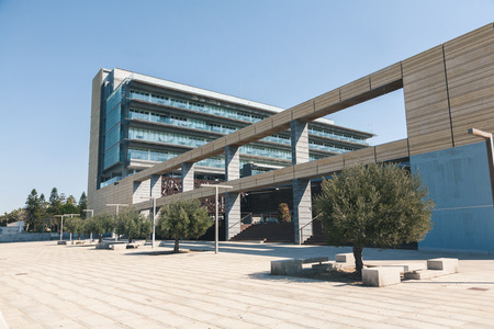 view of building with arc under clear sky, spain Редакционное