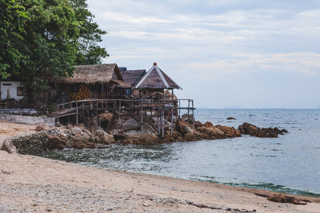 cozy wooden shacks at sea coast on cloudy day 스톡 콘텐츠