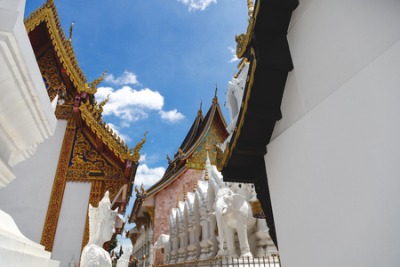 beautiful thai temple in front of clear blue sky Stock Photo