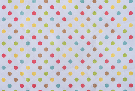pink wrapper design with colorful dots