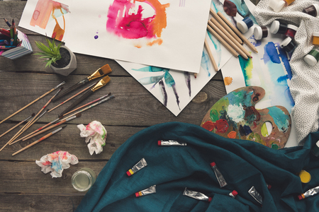 Top view of scattered painter sketches on a working table