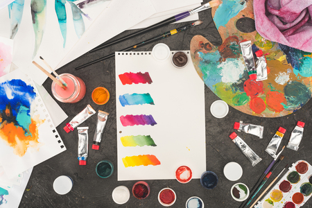 Top view of sketch of mixed watercolor paints on a concrete table Stock Photo
