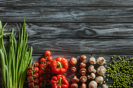 top view of various raw vegetables on wooden tabletop Stock Photo