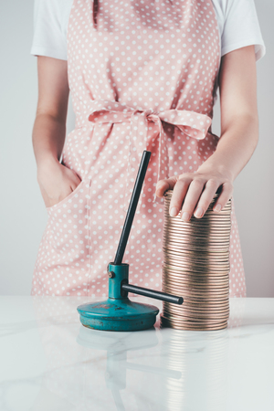 cropped image of woman in apron touching jar lids at kitchen Banco de Imagens