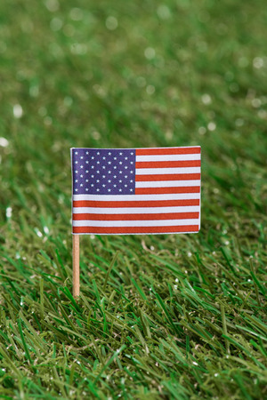 close up view of american flagpole on green grass 写真素材 - 105675806