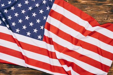 top view of folded american flag on wooden tabletop, americas independence day concept 写真素材
