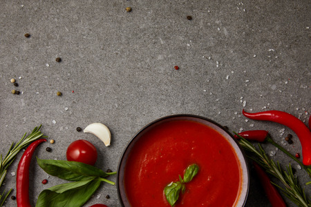 top view of delicious tomato soup and vegetables on grey table Stok Fotoğraf - 105679303