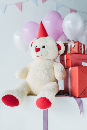 teddy bear in cone with gift boxes and air balloons Stok Fotoğraf