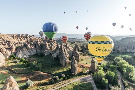 CAPPADOCIA, TURKEY - 09 MAY, 2018: colorful hot air balloons flying in sky above famous goreme national park, cappadocia, turkey Editorial