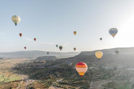 CAPPADOCIA, TURKEY - 09 MAY, 2018: beautiful colorful hot air balloons flying above cappadocia, turkey Editorial