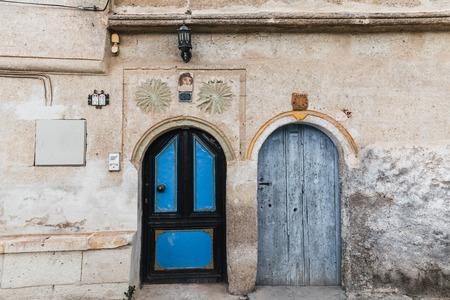 two wooden doors in traditional old building, cappadocia, turkey