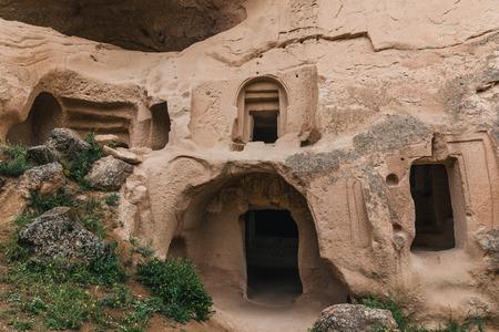 beautiful artificial caves in sandstone at famous cappadocia, turkey Imagens