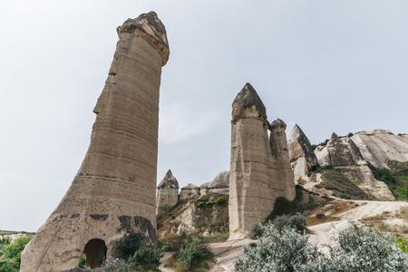 low angle view of bizarre rock formations in cappadocia, turkey