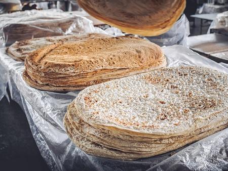 stacks of lavash bread selling on farmers market at Armenia