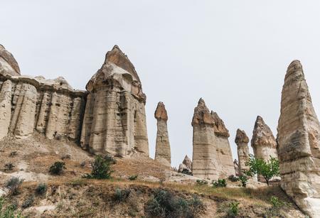 majestic rock formations against cloudy sky in famous cappadocia, turkey 版權商用圖片