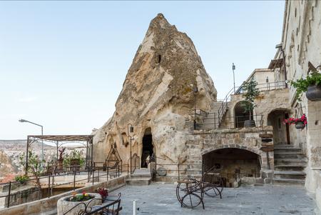 entrance to cave in bizarre rock and beautiful architecture, cappadocia, turkey