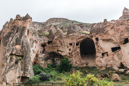 majestic caves and bizarre rock formations in famous cappadocia, turkey Imagens