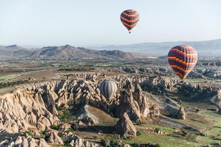 CAPPADOCIA, TURKEY - 09 MAY, 2018: hot air balloons flying above majestic goreme national park, cappadocia, turkey Imagens