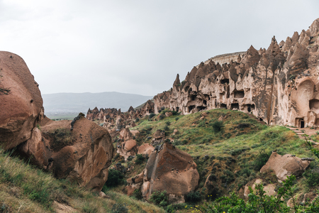 majestic view of scenic caves and bizarre rock formations in famous cappadocia, turkey