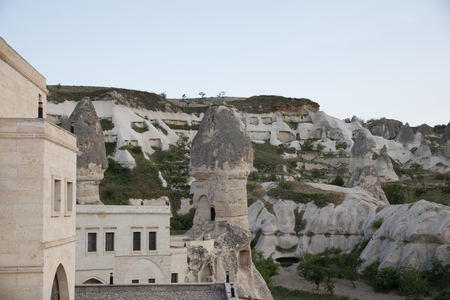 traditional buildings and majestic rock formations in cappadocia, turkey