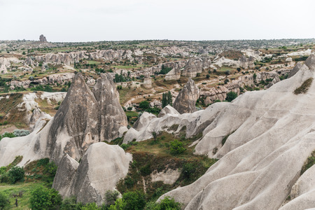 aerial view of majestic landscape with famous rock formations in goreme national park, cappadocia, turkey Imagens