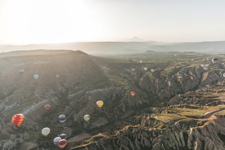 CAPPADOCIA, TURKEY - 09 MAY, 2018: various colorful hot air balloons flying above goreme national park, cappadocia, turkey Stock Photo