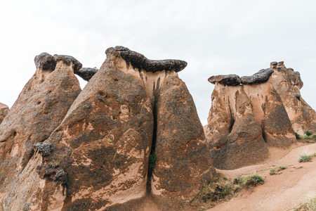 beautiful bizarre eroded rock formations in cappadocia, turkey
