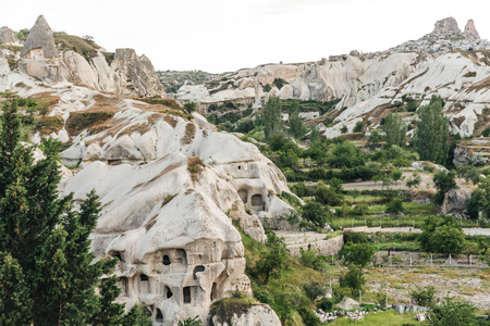 beautiful view of caves and rocks in goreme national park, cappadocia, turkey