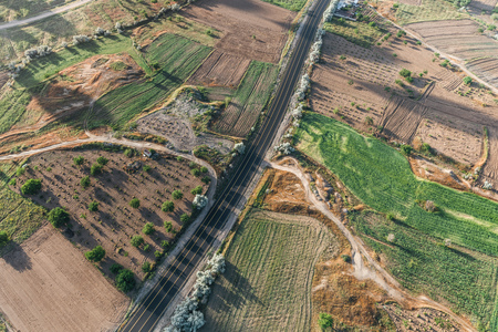 aerial view of road, fields and green vegetation in cappadocia, turkey Imagens