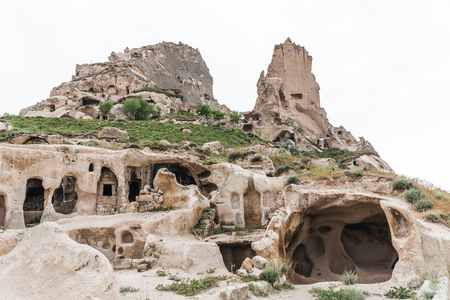 scenic view of caves in limestone at famous goreme national park, cappadocia, turkey Imagens