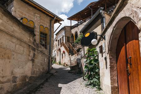 cozy narrow street with traditional old buildings in cappadocia, turkey