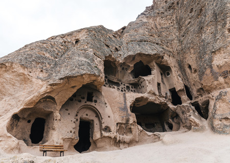 low angle view of majestic caves in limestone at famous cappadocia, turkey Imagens
