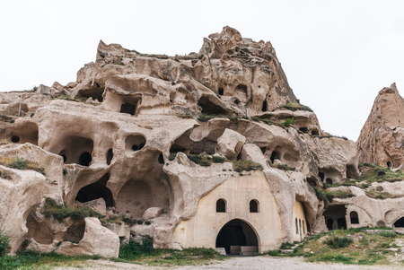 caves in limestone at famous goreme national park, cappadocia, turkey