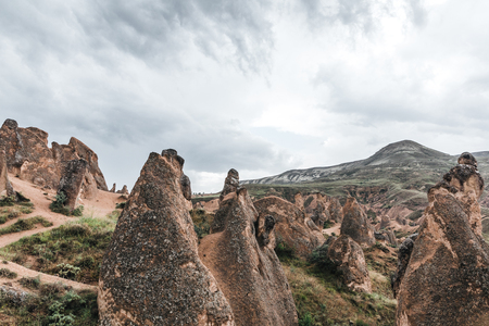 majestic geological formations and cloudy sky in cappadocia, turkey Stock fotó