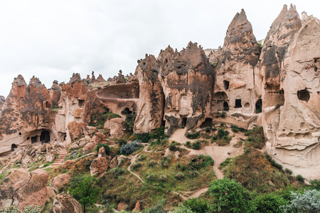 majestic view of scenic caves in limestone at famous cappadocia, turkey