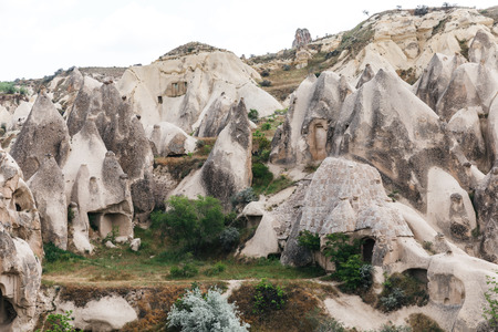 beautiful landscape with famous caves and rock formations in goreme national park, cappadocia, turkey 写真素材