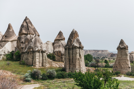 beautiful rock formations against cloudy sky in famous cappadocia, turkey