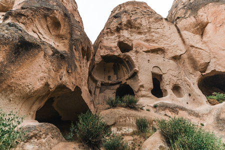 low angle view of beautiful caves in sandstone at famous cappadocia, turkey