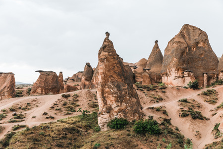 scenic landscape with eroded bizarre rock formations in famous cappadocia, turkey 写真素材