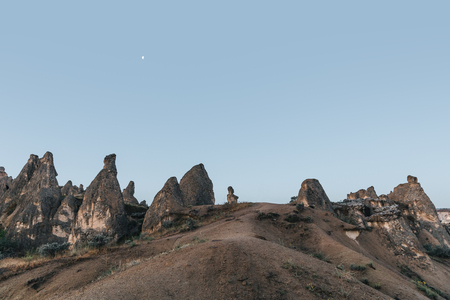 beautiful landscape with bizarre rock formations at evening, rock formations, turkey Imagens