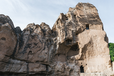 low angle view of beautiful rocks with caves in goreme national park, cappadocia, turkey Imagens