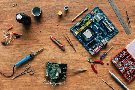 top view of repairing tools, motherboard and hard drive on wooden table Zdjęcie Seryjne