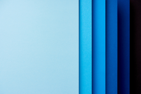 Pattern of vertical overlapping paper sheets in blue  tones