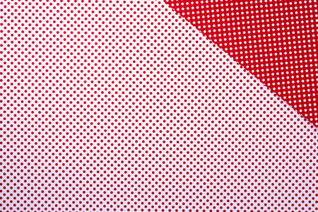 top view of vivid red and white surface with polka dot pattern for background