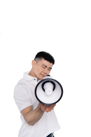 portrait of asian man pointing at camera with bullhorn isolated on white