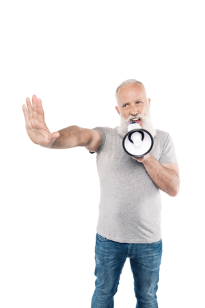 portrait of shouting senior man with loudspeaker and outstretched arm isolated on white Banco de Imagens - 105709427