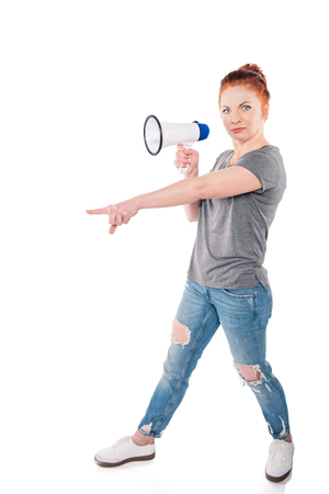 side view of shocked woman with megaphone pointing away isolated on white