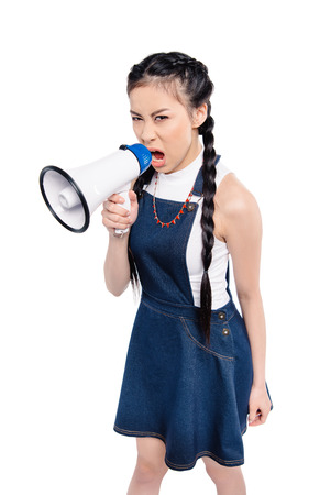 portrait of screaming asian woman with loudspeaker looking at camera isolated on white