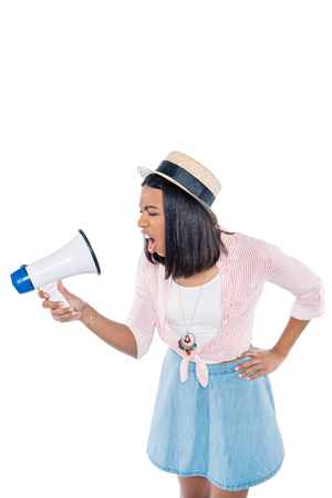 portrait of angry african american woman screaming into loudspeaker isolated on white Banco de Imagens - 105722870