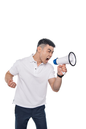 portrait of asian man screaming in bullhorn isolated on white